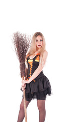 Halloween witch in black dress with broom.