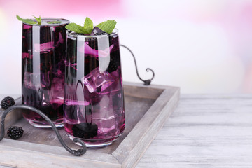Tasty cool blackberry lemonade with ice