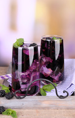 Tasty cool blackberry lemonade with ice