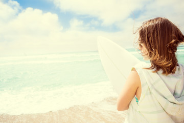 Surfer girl on the beach