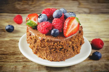 chocolate cake with raspberries, blueberries and strawberries