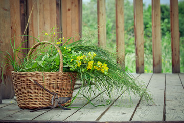 Basket of wild flowers and grass and old pruning shears on count