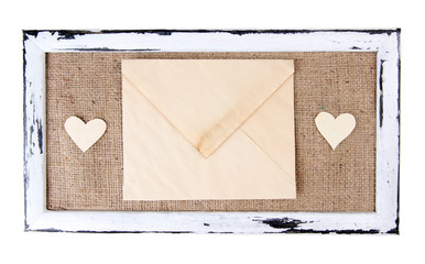 Wooden frame with love letter isolated on white