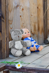 Childs toys left on a country house wooden porch