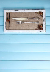 Wooden frame, spices and vintage cutlery
