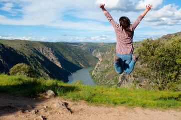 Young woman jumping. Arribes del Duero river natural park