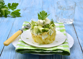 Vegetable salad with potatoes,eggs and cucumber.