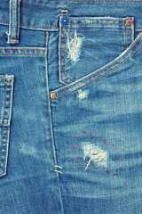 Close-up blue denim with a pocket .Blue jeans background .