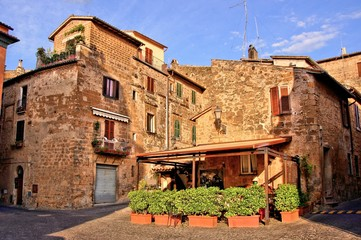 Outdoor cafe in the picturesque old town of Orvieto, Italy