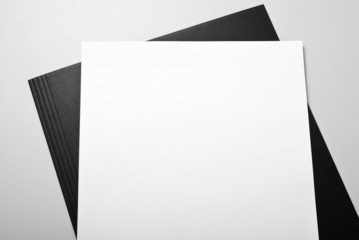 Blank sheet of paper and folder