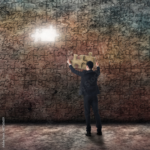 businessman with puzzle Poster