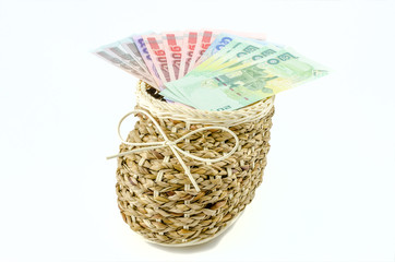 Basket with money on isolated background