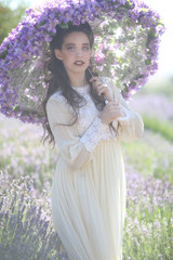 Pretty Young Girl Outdoors in a Lavender Flower Field