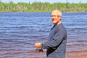 Retired Senior Male lake fishing