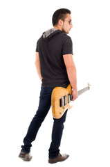 young guy holding electric guitar