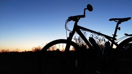 Mountain bike in silhouette, dusk