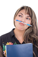girl holding pen with her mouth