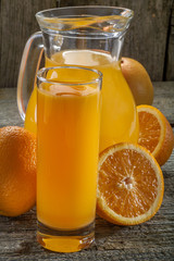 A refreshing orange juice on rustic wooden background