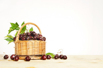 Ripe cherry berries in a wicker basket