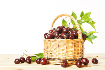 Ripe red cherry in a wicker basket