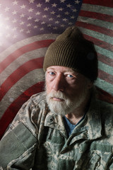 Senior military man in front of American flag