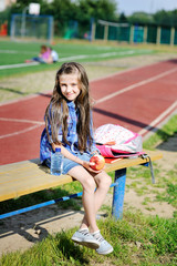 Portrait of beauty pre-teen tween kid girl on the soccer field