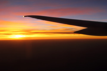Airplane wing with sunrise