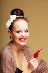 Happy smiling woman fashion girl retro style with chilli pepper