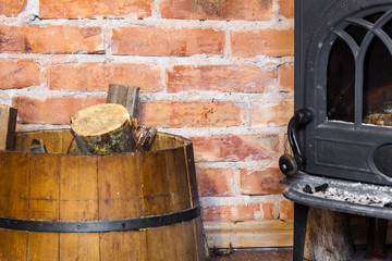 fire place and barrel with wood