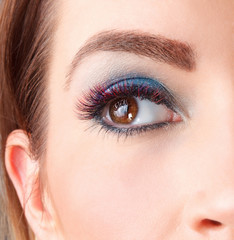Close up of colored eyelash extensions