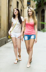 girls walking through  European city