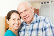 smiling mature couple  in home