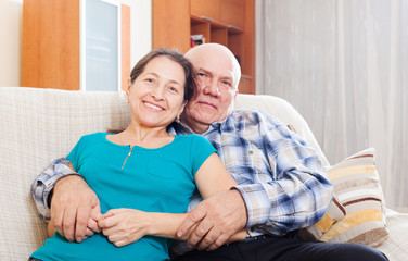 laughing mature woman with elderly man