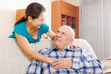 smiling senior man with mature wife