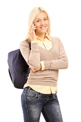 Young woman with backpack talking on the phone