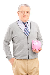 Vertical shot of a mature man holding a piggybank