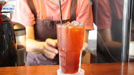 Barista Serving A Glass Of Iced Lemon Tea, Stock Video