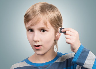 Boy inserting SD card into his head