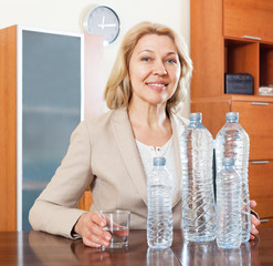 mature businesswoman with clean water at table