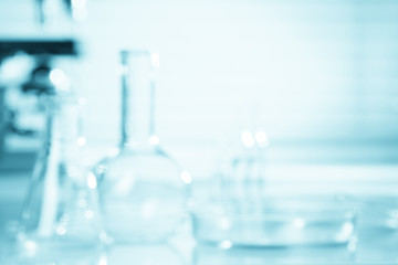 Blurred science background, test tubes and microscope