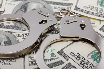 Handcuffs on money close up