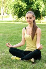 A girl performs exercises of yoga