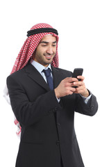 Arab saudi executive smiling and using a smart phone