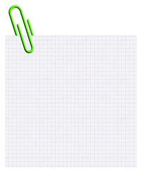 trombone vert sur carré de papier quadrillé