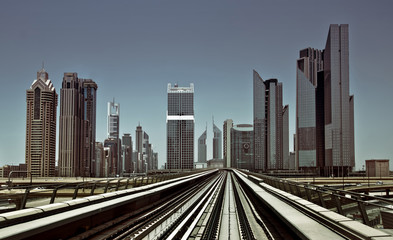 Dubai metro tracks with skyline