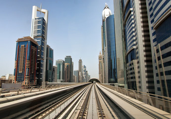 Dubai metro tracks with skyline