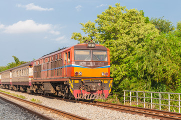 Railroad locomotive traveling in Thailand