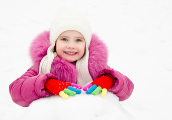 Cute smiling little girl playing outdoor