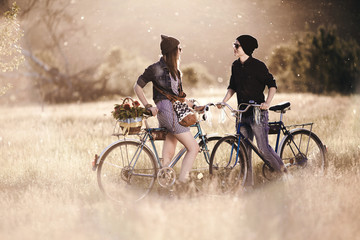 Two beautiful hipsters standing outdoor