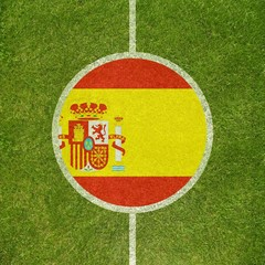 Football field center closeup with Spanish flag in circle